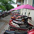Umbrella attachment for you motor scooter
